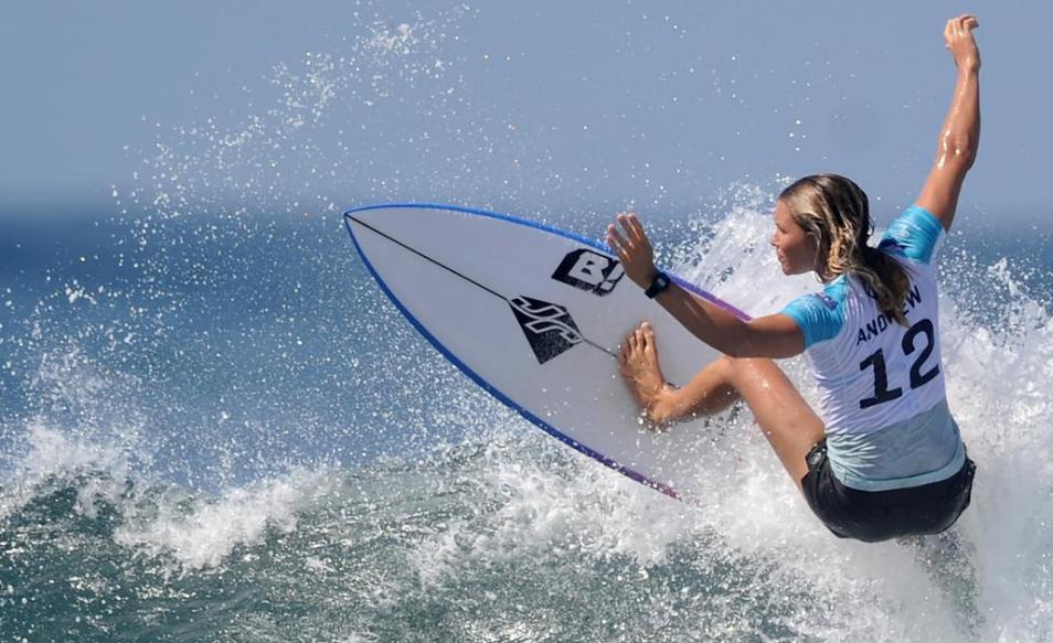 Gianyar Keramas Beach Bali woman surfing