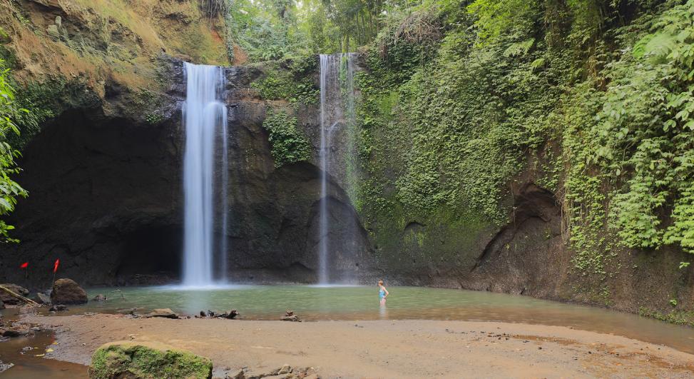 Tibumana Waterfall woman self