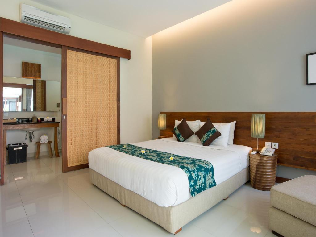 uma karan hotel seminyak bali bed room